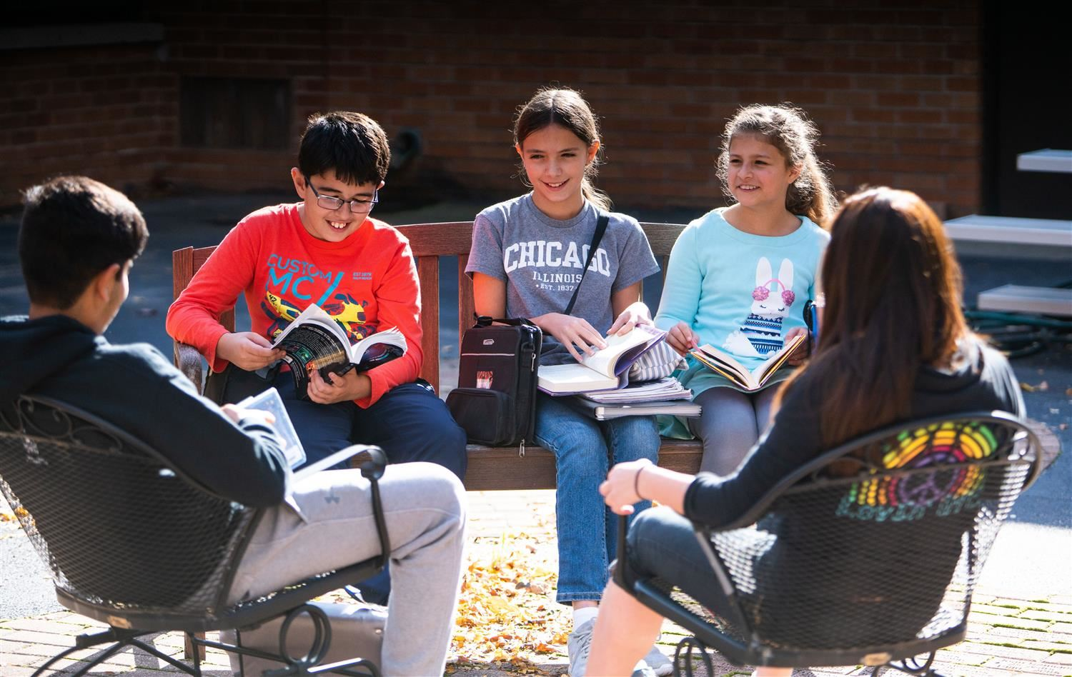 Students reading books outside